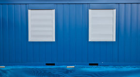 Windows and Blue Wall Royalty Free Stock Photography