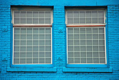 Windows in blue wall Royalty Free Stock Images