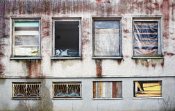 Windows boarded up by wooden panels in an old house Stock Photos
