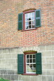 Windows in a brick house stock photo