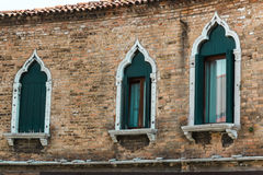 Windows and Brick Wall Facade in Murano Isle near Venice, Italy Royalty Free Stock Images