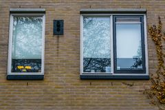 Windows in a brick wall, Modern dutch city architecture, architectural background royalty free stock images