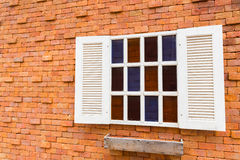 Windows on brick wall. White windows on red color brick wall Royalty Free Stock Image