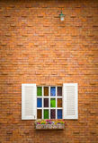 Windows on brick wall. White windows on red color brick wall Stock Photos