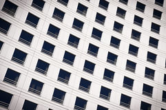 Windows of a building. A stock photo of a wall of windows on a building Royalty Free Stock Images