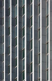 Windows on building. Aligned windows in business building, symmetry Royalty Free Stock Photography
