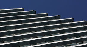 Windows on building. Aligned windows in business building, symmetry Royalty Free Stock Images