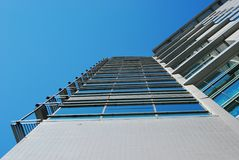 Windows and building. Big building and blue sky and more windows royalty free stock images