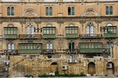 Windows. Building with lots of different windows in Valletta Royalty Free Stock Images