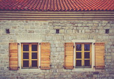 Windows of a building with Venetian architecture inside the old town of Budva, Montenegro. Royalty Free Stock Image