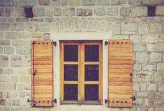 Windows of a building with Venetian architecture inside the old town of Budva, Montenegro. Royalty Free Stock Photo