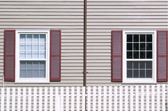 Windows with burgundy shutters Royalty Free Stock Photography