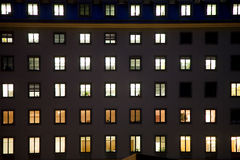 Windows of a business house with light by night Stock Images