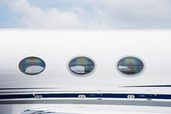 Windows of business jet Stock Images