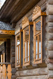Windows with carved wooden trims Royalty Free Stock Photos