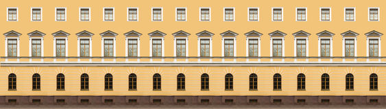 Windows in classicism style. Yellow wall with windows in classicism style Stock Image