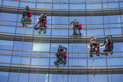Windows cleaners on skyscraper Royalty Free Stock Photography