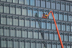 Windows Cleaners using a Crane Royalty Free Stock Images