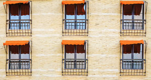 Windows. Closed Windows with Orange Awnings Stock Images