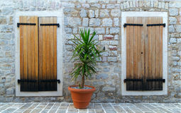 Windows closed by a wooden shutters Royalty Free Stock Photos