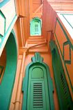 Windows of a Colonial Bungalow. Windows of a colourful British colonial era bungalow in Malaysia Stock Image