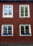 Windows on a colorful house. Royalty Free Stock Images