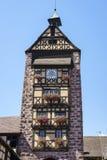 Windows con i fiori nell'Alsazia, Francia Immagini Stock