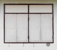 Windows concrete walls. Background brown sash windows and concrete walls of the house Stock Image