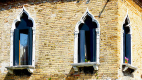 Windows at coroner of house building Royalty Free Stock Images