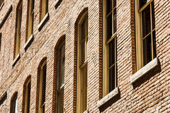 Windows in Cracked Brick Wall Royalty Free Stock Images