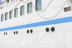 Windows of the cruise liner. Windows of the cruise liner are on board. Close-up Royalty Free Stock Photos