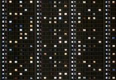 Windows de um prédio de apartamentos Imagens de Stock