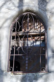 Windows with decorative grids and patterns on the ruins of an old historic Christian Church Royalty Free Stock Photo