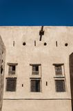 Windows on desert fort. Facade with mirrors and holes of a desert fortress Stock Photo