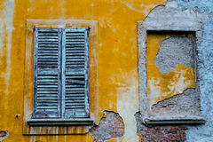 Windows in disrepair and plaster ruined Royalty Free Stock Images