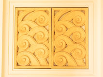 Thailand pattern gold color window door pottery by Royalty Free Stock Photos