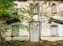 Windows and doors of an abandoned house covered with bricks.  stock images