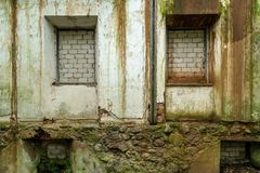 Windows and doors of an abandoned house covered with bricks.  stock photography