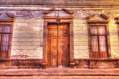 Entryway for an old building in San Luis Potosi, Mexico. Windows and doors of a building in San Luis Potosi`s downtown Royalty Free Stock Images