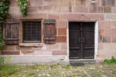 Windows and doors in the old European style. Old windows and doors in the old European style stock photo
