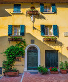 Windows and doors in an old house decorated with flower Royalty Free Stock Photography