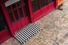 Windows and doors of red building and cobblestone floor Royalty Free Stock Image