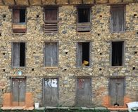 Windows and Doors of a traditional house in Nepal. Windows and doors of a traditional old house made from large rocks in the remote village and mountains of royalty free stock photos