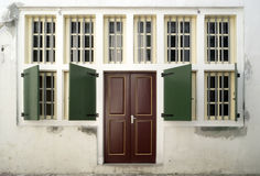 Windows and Doors. Vintage wall of windows and doors in Batavia, Jakarta; Dutch architecture royalty free stock photo