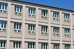 Windows of the elementary school building. Facade stock photography