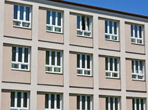 Windows of the elementary school building. In a row stock photography