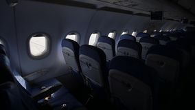 The windows of an empty plane in flight are high in the sky of Asia. Shooting in motion. The windows of an empty plane in flight are high in the sky of Asia stock footage