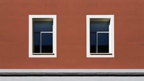 Windows en un edificio rojo Imagen de archivo libre de regalías