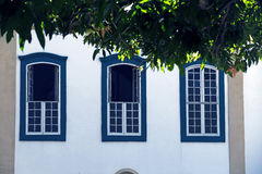 Windows in facade of colonial style, in Sao Paulo. SAO PAULO, SP, BRAZIL - MAY 16, 2015 - Windows in colonial style of the Monastery of Luz one of the last stock photography