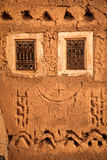 Windows. Facade detail . Ouarzazate. Morocco. Little windows with tradidional patterns in the kasbah. Ouarzazate. Morocco Royalty Free Stock Images